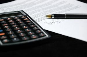 Dakota Electric Association | Custom EnergyGrant® | Image of calculator and paper