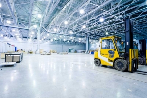 Warehouse with bright lights and forklift