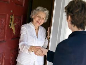 Woman greeting elderly neighbor
