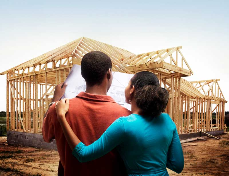 Couple looking at house construction