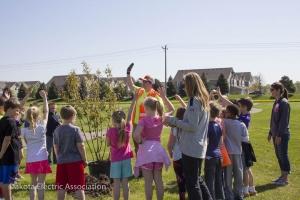 school children planting trees