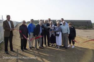 The board of directors cut the ribbon on the new 1 megawatt solar facility.