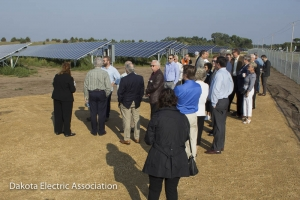 Dedication attendees viewing the solar panels.