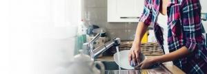 woman at sink washing dishes