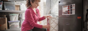 Woman changing furnace filter