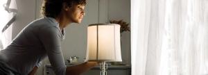 lady turning on lamp