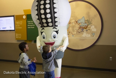 LED Lucy greeting children.