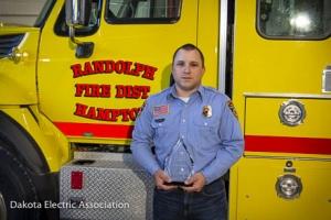 Jake Toledo holding the Dakota Spirit of Excellence Award.