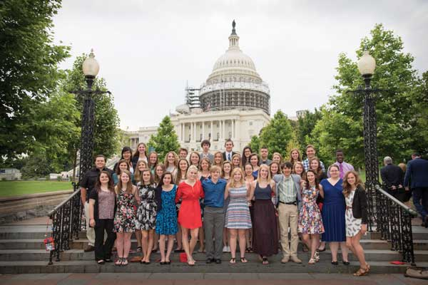 Youth Tour students posing in front of U.S. Capitol Building