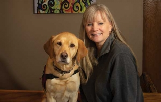 Linda Ball, founder and executive director of PawPADs, and Tory, the organization's ambassador dog.