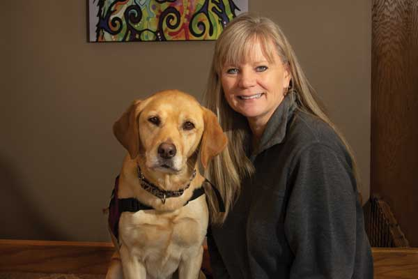 Linda Ball, founder and executive director of PawPADs, and Tory, the organization's ambassador dog.