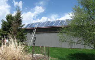 shed with solar panels installed on the roof