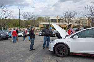 Gentleman looking at electric vehicles