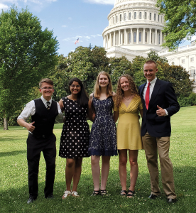 Five students in front of capitol