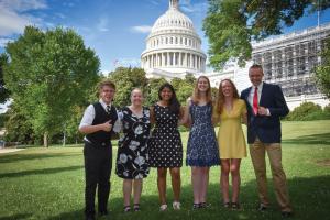 Davin, Wendy, Sanjana, Sara, Emma and Nils outside Capitol Hill