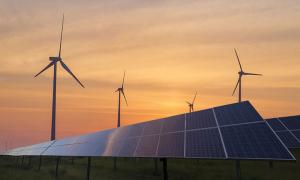 Solar Panels and Wind Turbines at sundown