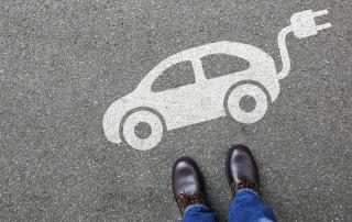 EV stencil on road