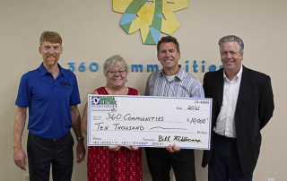 4 people with big check