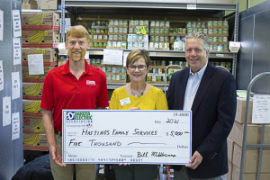 three people hoilding large check